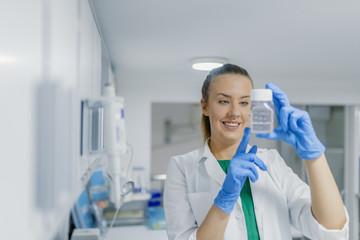 Portrait of beautiful blond woman working in modern laboratory