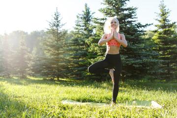 Image of female athlete practicing fitness