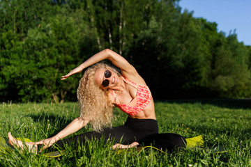 Image of sportswoman exercising on rug