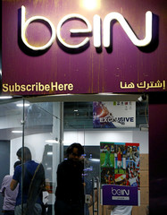 Egyptian clients wait at one of the outlets of Qatari-funded beIN Sports channel in Cairo