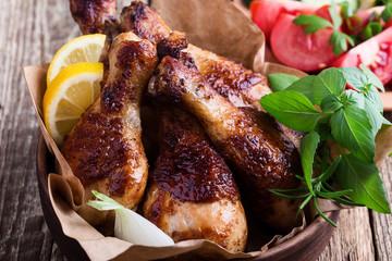 Chicken drumsticks and fresh vegetables, favorite meal