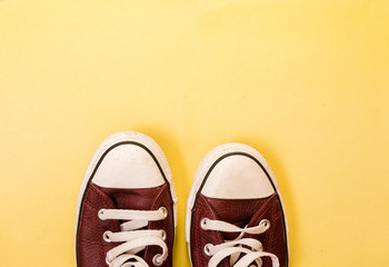 sneakers on isolated yellow background