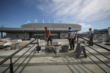 Workers in front of Rostov Arena