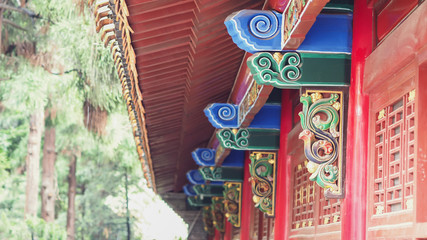 A Beautiful and Colorful Chinese Style Outdoor Architecture Shows The  Roof and Window / Door Structures.  Selective Focus and Blurred Background.