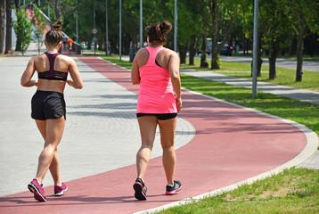Women run on the running track