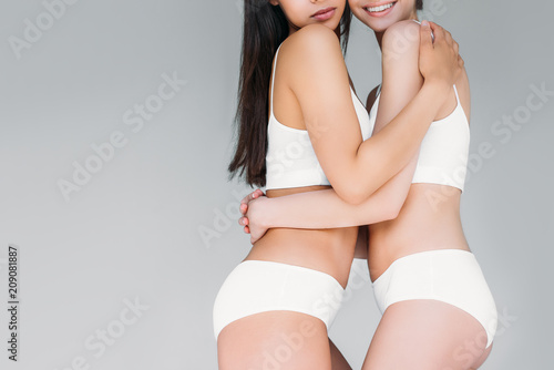 927c13ee85 cropped image of two women embracing each other isolated on gray background
