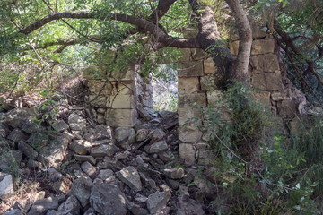 Ruins  of abandoned Palestinian village Kafr Birim in the north of Israel in which the christians Maronites lived until the middle of the 20th century