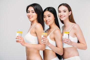 d7a4b3d88b beautiful smiling multiethnic girls holding glasses with lemon water