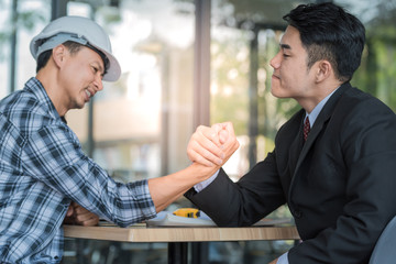 Young business man Arm wrestle together, competition concepts.