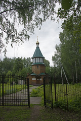 wooden chapel on a clearing among a birch bosk