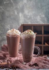 Chocolate milkshake in tall glass mugs