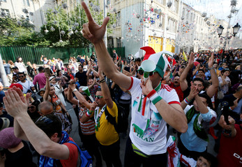 Supporters of the Iranian national soccer team cheer during a gathering on the eve of the 2018 FIFA World Cup in central Moscow
