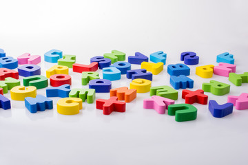 Colorful letter blocks scattered randomly on white