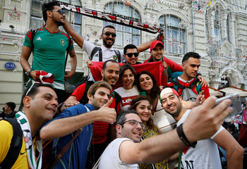 Football supporters take a selfie during a gathering on the eve of the 2018 FIFA World Cup in central Moscow