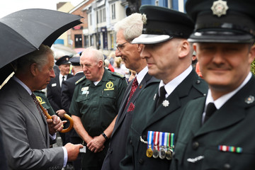 Britain's Prince Charles greets first responders to the Omagh bombing, in Omagh, Northern Ireland