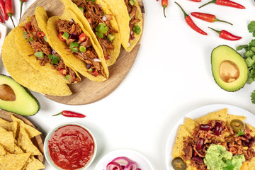 Overhead photo of typical Mexican dishes on white with copy space
