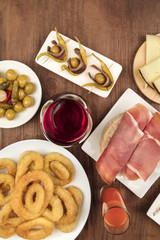 Spanish food. Overhead photo of different tapas with wine, with copy space