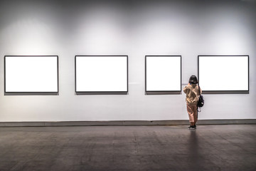 woman waching  in the gallery