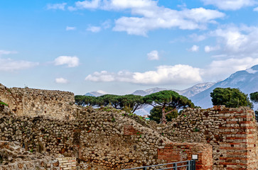 Ruins of Pompeii with Vesuvius in background- archaeological site of Naples, Italy