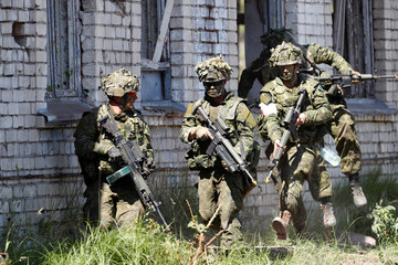 Canadian soldiers take part in the urban fighting drill during the NATO Saber Strike exercise in the Soviet-time former military town near Skrunda