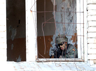 Spanish soldier takes part in the urban fighting drill during the NATO Saber Strike exercise in the Soviet-time former military town near Skrunda