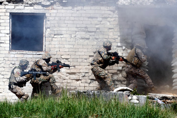 Latvian National Guard unit takes part in the urban fighting drill during the NATO Saber Strike exercise in the Soviet-time former military town near Skrunda