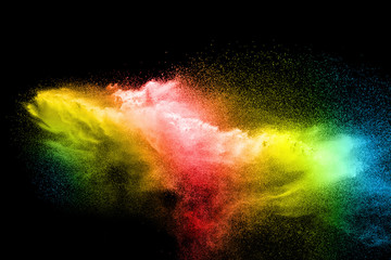 Multicolored particles explosion on black background.