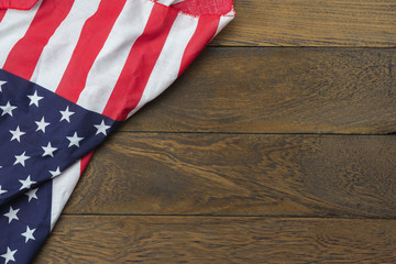 Table top view 4 th July independence day holiday background concept.Flat lay USA flag for sign of season on modern rustic brown wooden at office desk.Free space for creative design text & content.