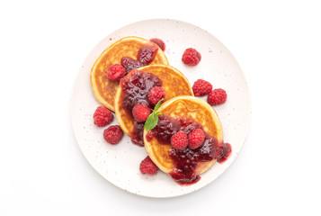 pancake with fresh raspberries and raspberry sauce