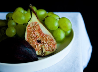 Plate with figs and grapes.
