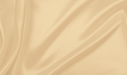 Smooth elegant golden silk or satin luxury cloth texture as wedding background. Luxurious...