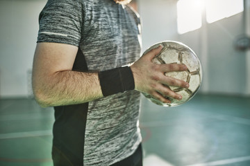 Close-up of indoor soccer player holding the ball