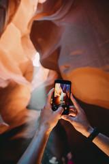USA, Arizona, Man taking photo with mobile in Antelope Canyon