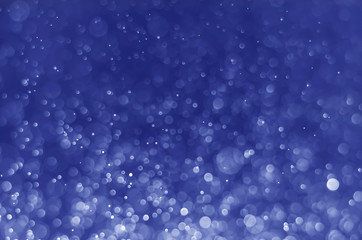 abstract blue bokeh glitter sparkle background.