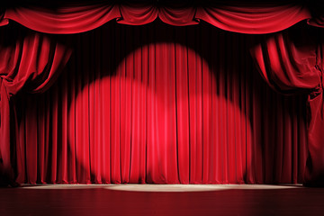 Theater stage with red velvet curtains with spotlights