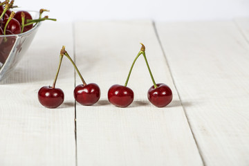 Cherry ripe, fresh on a wooden table. Cherry red ripe. Fresh cherry on a wooden table.