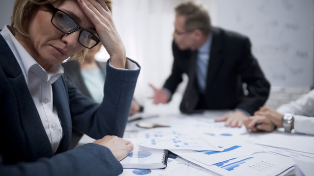 Female trying to abstract from screaming boss, occupational burnout, overworked