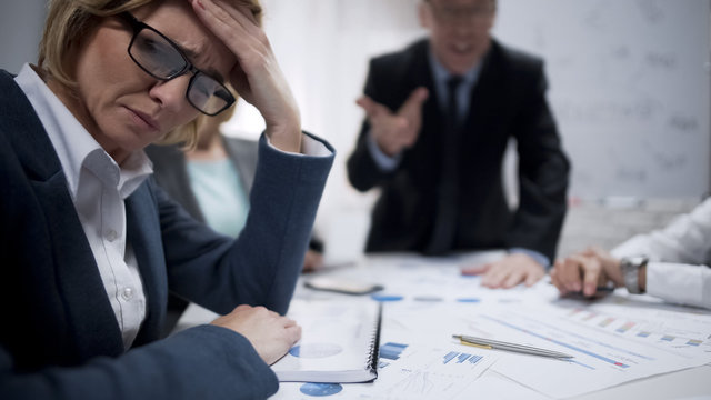 Woman consultant feeling stress at meeting, occupational burnout, overworked