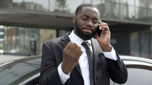Businessman annoyed by unpleasant phone conversation, problems in business