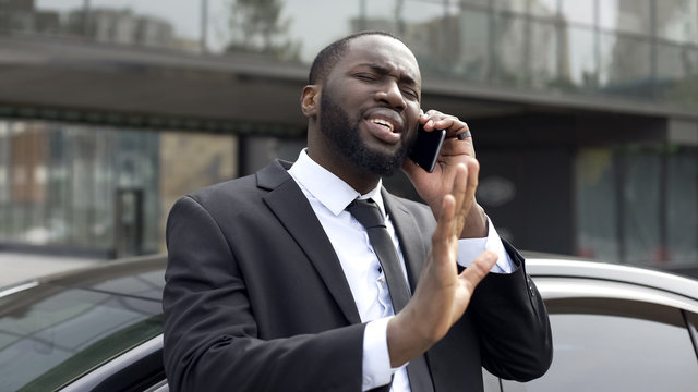 Afro-American diplomat negotiating by phone, defending his interests and opinion