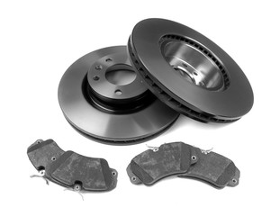 Set of brake discs and pads. Isolate on white