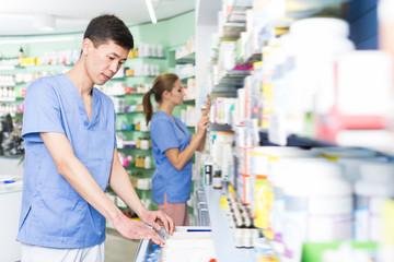 Nice japan man is searching medicines on shelves