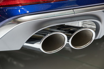 Chrome exhaust pipes on a sports car