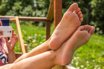 woman bare feet in rest time on green summer  unfocused background environment