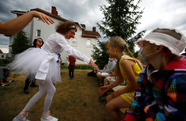 """Clowns from youth charitable public association """"Hospital clowns Funny nose"""" perform for children suffering from cancer at the Catholic Charity Society """"Caritas"""" on the outskirts of Minsk"""