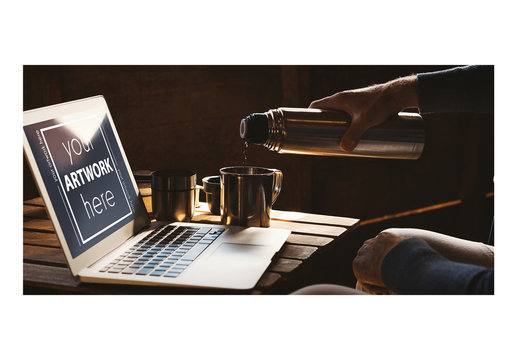 Man Pouring Coffee with Laptop Mockup