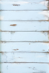 Blue distressed old barn wood textured background. Vertical.