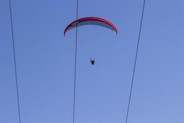 Skydiver on blue sky background
