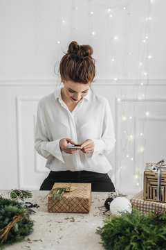 Woman Packing Christmas Presents