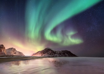 Northen light above mountains. Beautiful natural landscape in the Norway